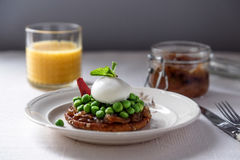 Bruschetta with green peas, mint and egg Royalty Free Stock Photography