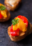 Bruschetta with grilled bell pepper over old dark tray Royalty Free Stock Images