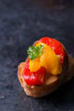 Bruschetta with grilled bell pepper over old dark tray Royalty Free Stock Image