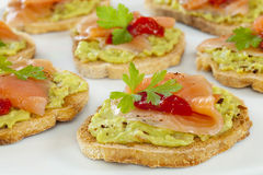Bruschetta with Guacamole, Smoked Salmon Stock Photo