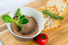 Bruschetta with humus on wooden plate Royalty Free Stock Images