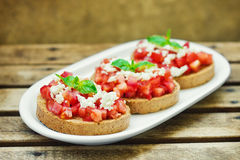 Bruschetta ( Italian Toasted Garlic Bread ) with tomato & cheese Stock Image