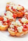 Bruschetta ( Italian Toasted Garlic Bread ) with tomato & cheese Stock Images