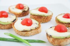 Bruschetta (Italian Toasted Garlic Bread ) with zucchini, cherry tomato and mozzarella Royalty Free Stock Image