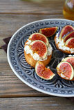 Bruschetta with juicy figs on a plate Royalty Free Stock Images