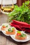Bruschetta mit Arugula und Tomaten stockfotos
