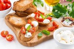 Bruschetta with mozzarella, basil and cherry tomatoes Stock Image