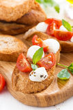 Bruschetta with mozzarella, basil and cherry tomatoes, vertical Royalty Free Stock Photography