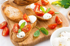 Bruschetta with mozzarella, basil and cherry tomatoes Stock Images
