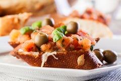 Bruschetta with mozzarella, tomato and olive Stock Photography