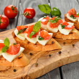 Bruschetta with mozzarella and tomatoes Stock Photos