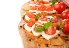 Bruschetta with mozzarella and tomatoes Royalty Free Stock Photography