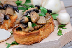 Bruschetta with mushroom and garlic on chopping board Royalty Free Stock Photo