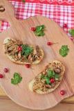 Bruschetta with mushrooms. On wooden board Royalty Free Stock Photo