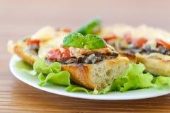 Bruschetta with mushrooms and cheese Stock Photo
