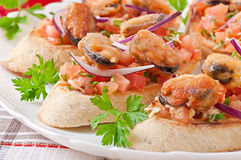 Bruschetta with mussels Stock Photo