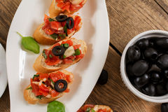 Bruschetta and olives. Italian treditional bruschetta with tomato basil and black olives Royalty Free Stock Photography