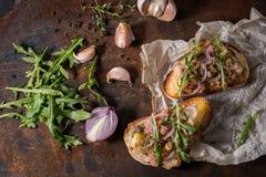 Bruschetta with onion arugula. And fish stock photography