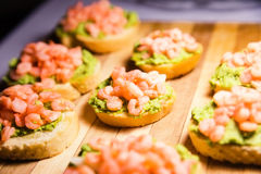 Bruschetta with a paste of green peas and shrimps Royalty Free Stock Image