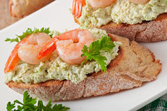 Bruschetta with a paste of green peas and shrimps Stock Photos