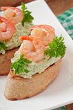 Bruschetta with a paste of green peas and shrimps Stock Images