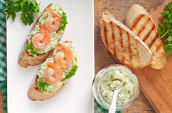 Bruschetta with a paste of green peas and shrimps Royalty Free Stock Photography