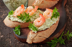 Bruschetta with a paste of green peas and shrimps Stock Image
