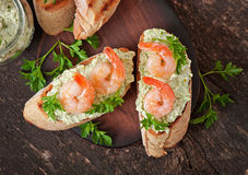 Bruschetta with a paste of green peas and shrimps Royalty Free Stock Photo