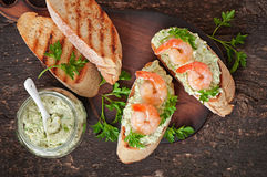 Bruschetta with a paste of green peas and shrimps Stock Photo