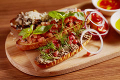 Bruschetta with pate and tomato. At wood plate Royalty Free Stock Images
