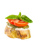 Bruschetta with pesto and cheese. Royalty Free Stock Image