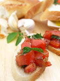 Bruschetta piece in front Royalty Free Stock Photography
