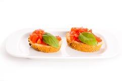 Bruschetta on plate Stock Images