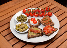 Bruschetta plate Stock Images