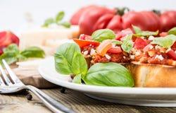 Bruschetta on a plate (macro shot) Stock Photography