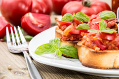 Bruschetta on a plate (macro shot) Stock Images