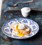 Bruschetta with poached egg. Breakfast with bruschetta with poached egg Stock Photography