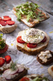 Bruschetta with poached egg and herbs Royalty Free Stock Photo