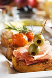 Bruschetta with prosciutto and olives Stock Image