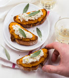 Bruschetta with pumpkin puree, ricotta and sage Royalty Free Stock Photo