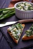 Bruschetta with ramson salad on slate background. Selective focus Stock Photo