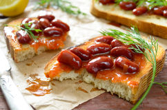 Bruschetta with red haricot bean, tomato sauce and dill Stock Photography