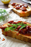 Bruschetta with red haricot bean, tomato sauce and dill Royalty Free Stock Photography