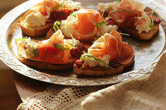 Bruschetta with ricotta, prosciutto and tomatoes Stock Images