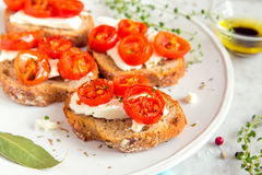 Bruschetta with roasted tomatoes Stock Images