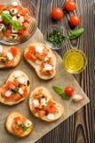 Bruschetta with roasted tomatoes, mozzarella cheese Royalty Free Stock Photos