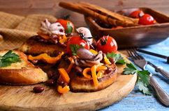 Bruschetta with salad vegetables and octopus Royalty Free Stock Photography