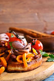 Bruschetta with salad vegetables and octopus Stock Photography