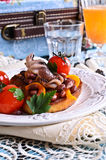 Bruschetta with salad vegetables and octopus Stock Image