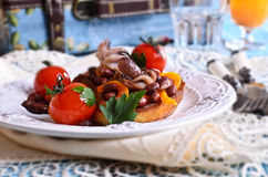 Bruschetta with salad vegetables and octopus Stock Photos